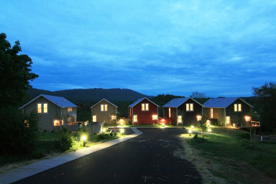 night view of new homes, all perched on the brow of the hill