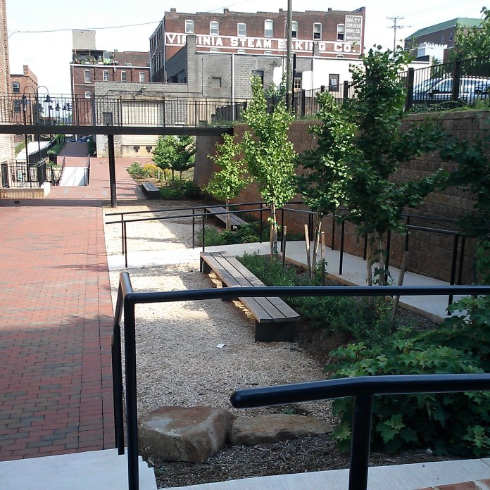 the bluff walk connects to the backs of existing commercial buildings -Lower Bluff Walk project